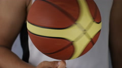 4K Close shot of unseen basketball player spinning a ball on his finger, in slow Stock Footage