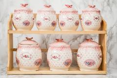 Ceramic Round Jars with Flower Ornaments Stock Photos