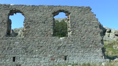 Ruins of an ancient wall on the sky background. - stock footage