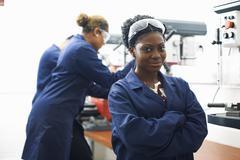 Portrait of female student in college metalwork workshop Stock Photos