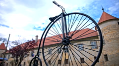 Penny-farthing bicycle low angle dolly slide Stock Footage