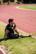 Athlete talking on the phone Stock Photos