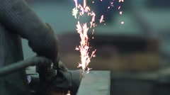 Brushed metal with sparks at the factory 2 - stock footage