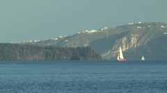 Sailboats sailing on the background of the high rocky coast. Stock Footage