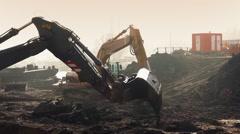 Excavators Digging Up Future Construction Site  Stock Footage