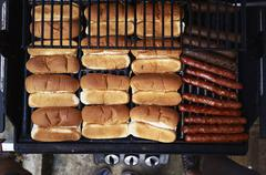 Hot dogs on bbq Stock Photos