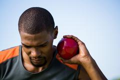 Male athlete holding shot put ball Stock Photos