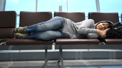 Attractive woman sleeping at the airport Stock Footage