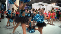 Young cheerleaders preparing for their performance backstage. - stock footage