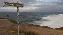 Timelapse Lighthouse in Nazare signal and waves Stock Footage