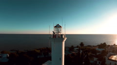 Aerial drone view flying around a lighthouse in Colonia del Sacramento, Uruguay Stock Footage