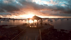 Waterfront pavilion overlooking harbor at sunset, Punta del Este, Uruguay Stock Footage