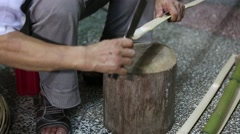 A craftsman cutting bamboo for use in Chinese lanterns Stock Footage