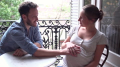 Expectant couple touching woman's stomach together Stock Footage