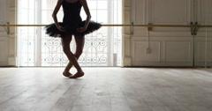 Slow motion shot of ballerina dancing in studio - stock footage