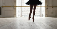 Slow motion shot of ballerina dancing en pointe in dance studio - stock footage