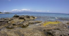 Blue waves and transparent, of the Ionian sea that burst the rocky shore Stock Footage