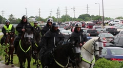 Policemen going by on horses (HD) Stock Footage