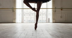 Ballerina performing pirouettes in studio, slow motion Stock Footage
