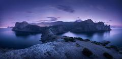Night landscape with mountains, sea and starry sky. Dusk - stock photo