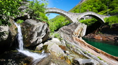 Double arch stone bridge, Lavertezzo, Verzascatal, Canton Tessin. Stock Footage