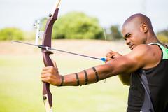 Athlete practicing archery Stock Photos