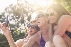 Three mature women in swimwear, taking self portrait Stock Photos