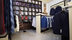 Fashion Man In Suit Posing In Wear Shop Stock Footage