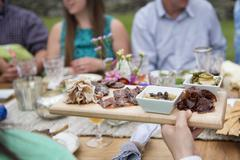 Family having meal together, outdoors - stock photo