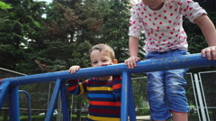 Kids Playing and Climbing on Playground Climbing Frame Stock Footage