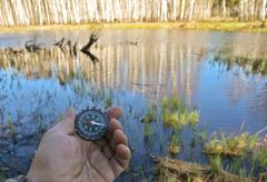 With compass on the walk. - stock photo