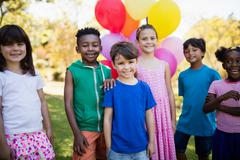 Cute children standing and posing during a birthday party - stock photo