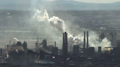 Pollution Large Factory Industry Against the Backdrop of City Buildings in the Stock Footage
