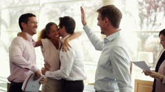 Business associates congratulating each other Stock Footage