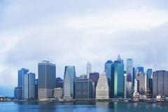 View of East river and Lower Manhattan skyline, New York, USA - stock photo