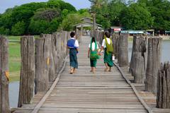 Amarapura, Myanmar - 28 June, 2015: Children in colorful clothes walk to scho Stock Photos