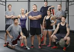 Portrait of eight male and female crossfit colleagues in gym Kuvituskuvat