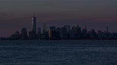 Time lapse of night falling over East River and Lower Manhattan, New York City Stock Footage