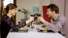Beautiful couple toasting with red wine at home 4K Stock Footage