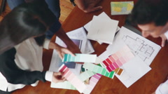 Interior decorator showing color swatches to client Stock Footage
