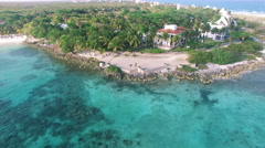 4K Aerial drone shot mexico akumal pan boat and houses - stock footage