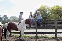 Horse riding, Pakiri Beach, Auckland, New Zealand Stock Photos