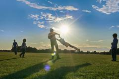 Family enjoying outdoor activities in the park - stock photo