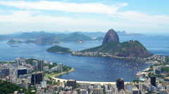 Airplane Flying in Front of Sugar Loaf Mountain in Rio de Janeiro, Brazil Stock Footage