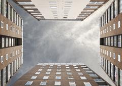 Low angle view of four apartment block exteriors face to face Stock Photos