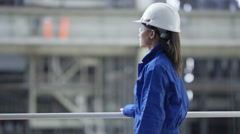 4K Portrait of smiling female engineer in the power industry. - stock footage