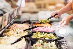 Close up view of hands picking prepared meals Stock Photos
