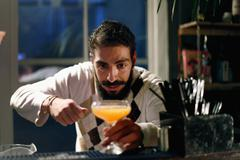 Bartender serving cocktail at bar Stock Photos