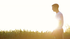 Young woman running and jumping into boyfriend's arms Stock Footage