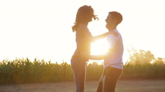 Carefree couple embracing and spinning outdoors Stock Footage
